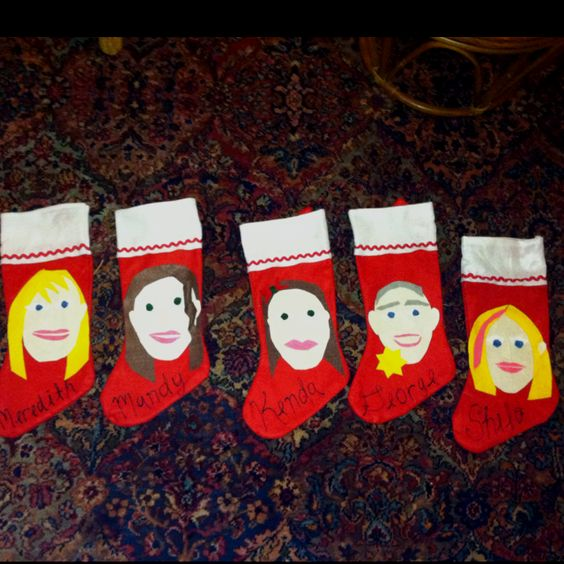 Homemade stockings with cut-out felt faces. Surprise! The elves have been busy