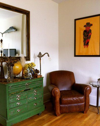 Love the brown couch and the green dresser. Perfect reading and imagining corner.