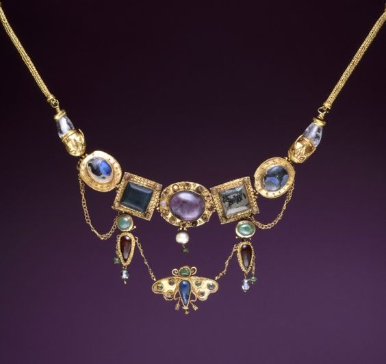An ancient Greek gold, amethyst, chalcedony, emerald, rock-crystal, pearl and glass necklace with a butterfly pendant; the butterfly, a symbol of the soul, was an appropriate motif for a burial gift, and this necklace was found on the neck of the deceased. (Walters Museum)