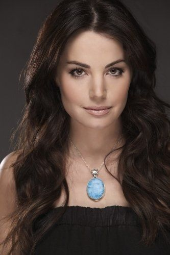 Erica Durance. Watching her on smallville really motivates me to work out and go kick some butt!