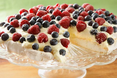 Pavlova with Lemon Curd and Fresh Berries.  Popular in Russia and Australia.