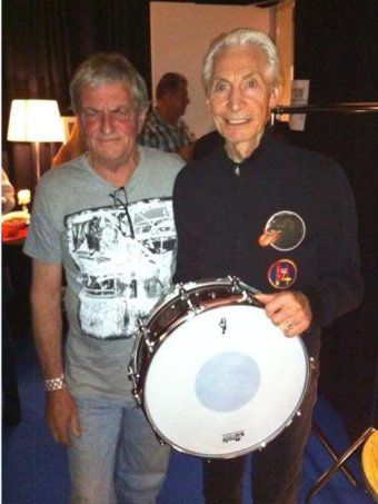 Drum maker Chris Brady with Rolling Stones drummer Charlie Watts......A Perth drum maker whose handcrafted instruments made from local timber are played by U2 and the Rolling Stones is hanging up his tools after 30 years.
