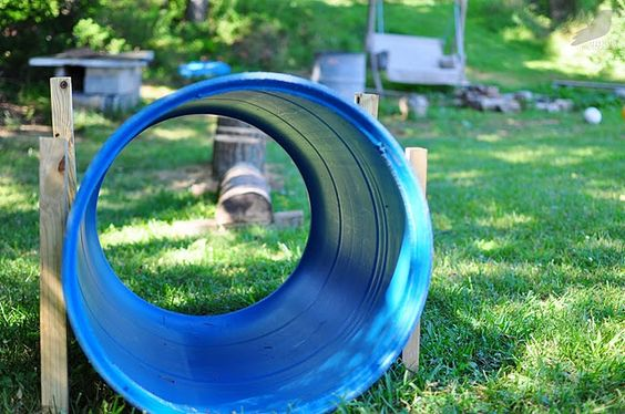 inexpensive outdoor play place - love the barrel tunnel