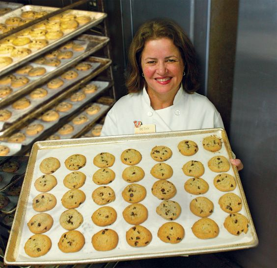 Bethy in her bakery with her signature chocolate chip cookies!