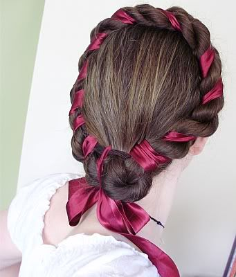 This is a funky twist to a romantic hair style. Take a colored ribbon and braid it through your hair. It is a fun way to liven up any hair style with a streak of color with out any dyes. =D