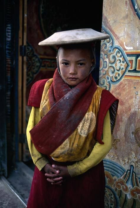 Tibetan Novice Monk. A śrāmaṇera is a novice male monastic in a Buddhist context. After a year or at the age of 20, a śrāmaṇera will be considered for higher ordination as a bhikṣu. Some monasteries will require people who want to ordain as a monk to be a novice for a set period of time, as a period of preparation and familiarization.   Photo by Steve McCurry