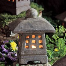 """Small Japanese stone garden lantern will brighten your deck or garden path. Holds a tealight or votive candle. 12 lbs, 10"""" h."""