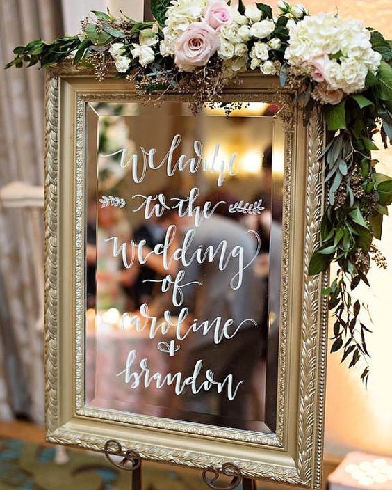 Wedding Mirror (Welcome Signs/wording equivalent) with custom wording in calligraphy. Script, block text and floral illustrations available for signs. $80.00 fee includes lettering fee, rental of sign and materials (chalk pens). To view entire rental inventory, visit our Facebook page: https://www.facebook.com/dotellcalligraphyanddesigns/ Easels available upon request for an additional $10.00 fee. Available to local customers in the Orlando/surrounding Orlando Area- Delivery Options availabl...: