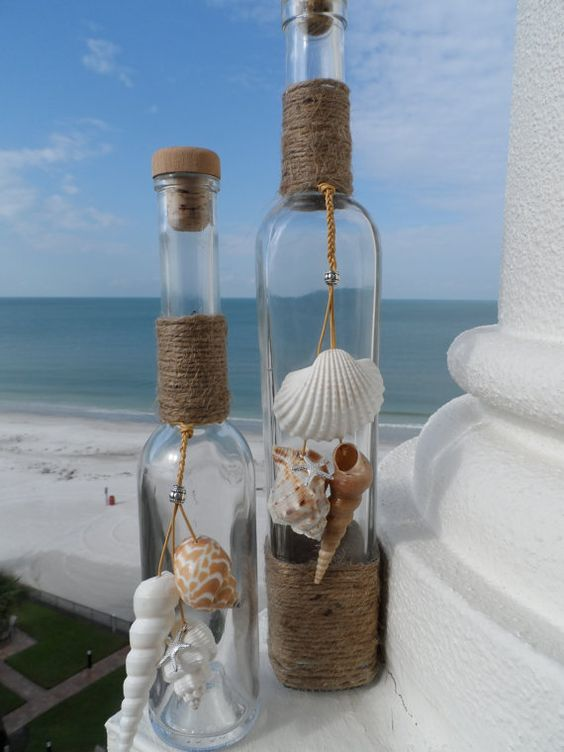 Beach Bottles with shells shell home decor by BytheShoreDecor, $28.00 These would be super cute as wedding decor :):