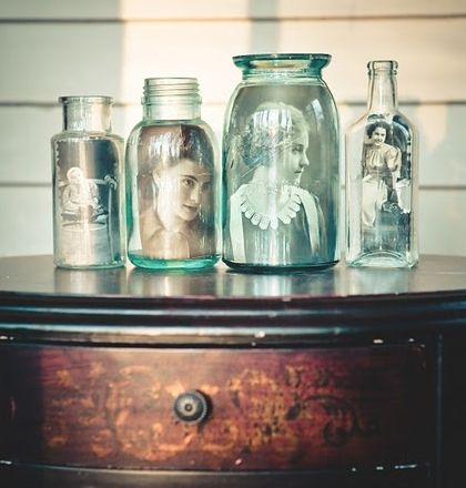 Decoration Ideas With Glass Bottles Vintage Photographs Tucked Into Glass Jars And Bottles  #glass