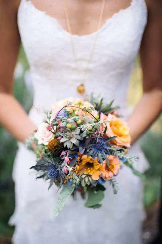 Unexpected Thistle and petite size of bouquet with Succulents, Rose, Hypericum berry, Vine, blue Hydrangea underlying, Rosemary, Nesturtium flower, Succulent flowers, Eucalyptus leaves quite interesting.