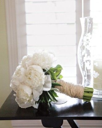 "See the ""Classic Bouquet"" in our Peony Wedding Bouquets gallery-- This classic bouquet of white peonies is wrapped in hemp for an earthy element."