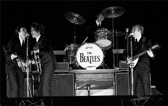 11th September 1964. The Beatles perform during high winds at the Gator Bowl, Florida. Ringo was forced to nail his drums down to avoid injury.