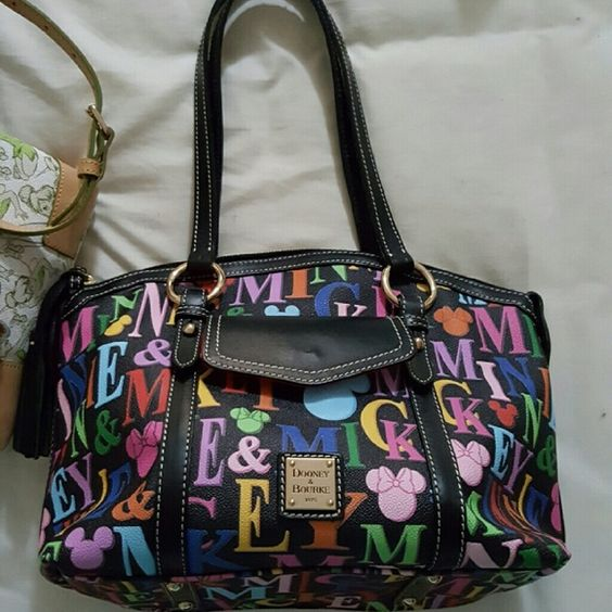 Disney Dooney and Bourke letters bag Like new. Nothing wrong with it. I didn't carry it very long. Bags Satchels