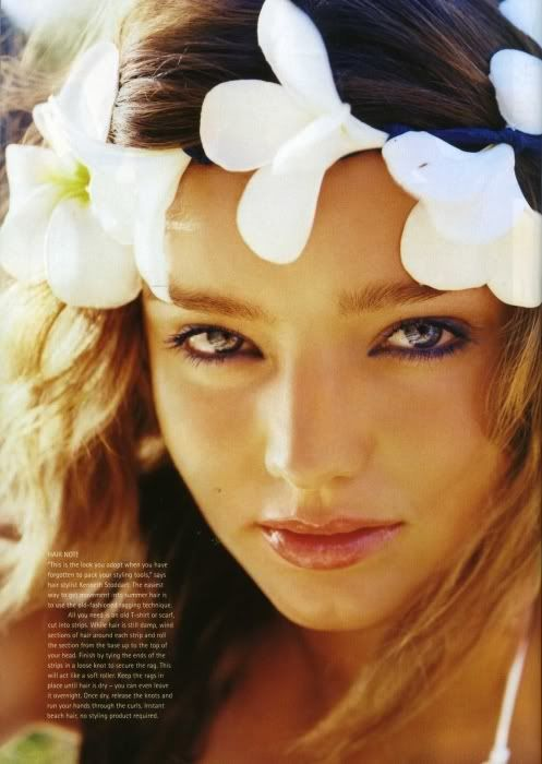 Beautiful eyes...luv the flowers in her hair...great skin tone...