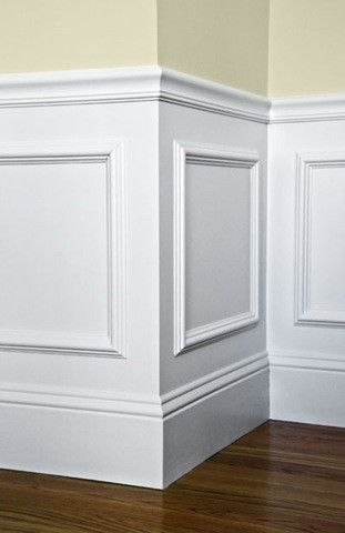 buy cheap frames form michaels for wainscoting and add a baseboard at top then paint