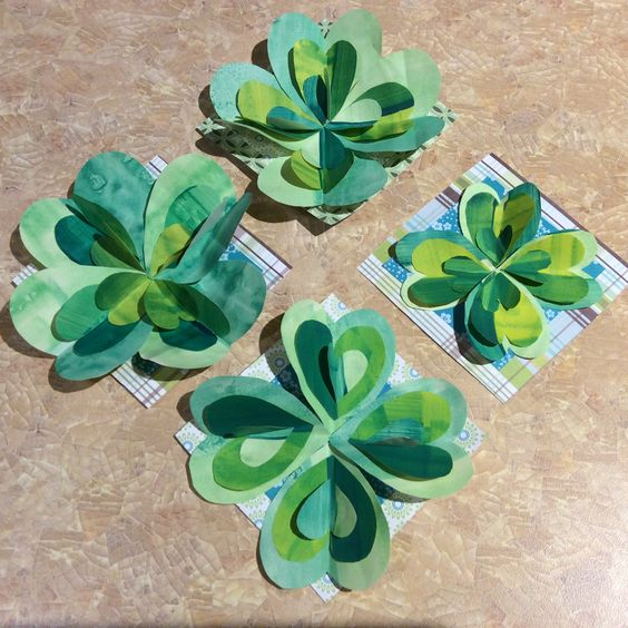 Layered shamrocks made from hearts cut out of striped green paper.  mecca has paper, paint and studio space at very affordable prices.