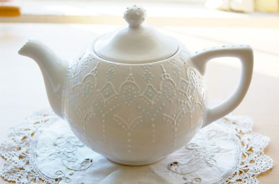 Victorian teapot handpainted with blue lace dotting.