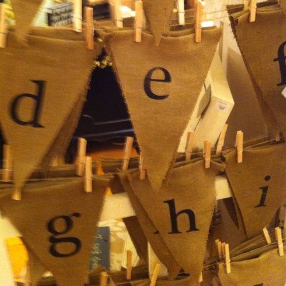 Burlap triangles with stencil letters!! Saw this in a store now will do at home!