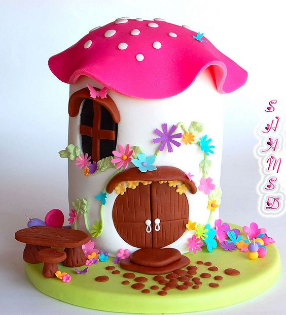 toadstool house cake... it'd be really cute with a half ball top instead of just a fondant cap.