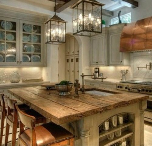 Love the rustic kitchen island would change the wall colors to turquoise and