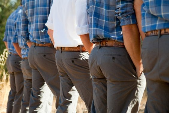 groom and groomsmen, blue gingham shirts, gray pants, custom engraved leather belts, men's attire, rustic blue and yellow wedding, Kim J Martin Photography