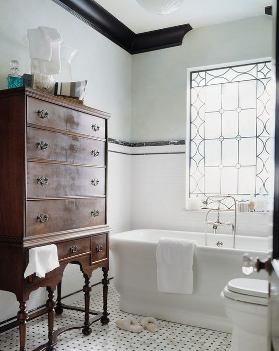 A piece of vintage furniture is always good in a bathroom with its modern clean lines and hard edges. It will soften the space and bring character.