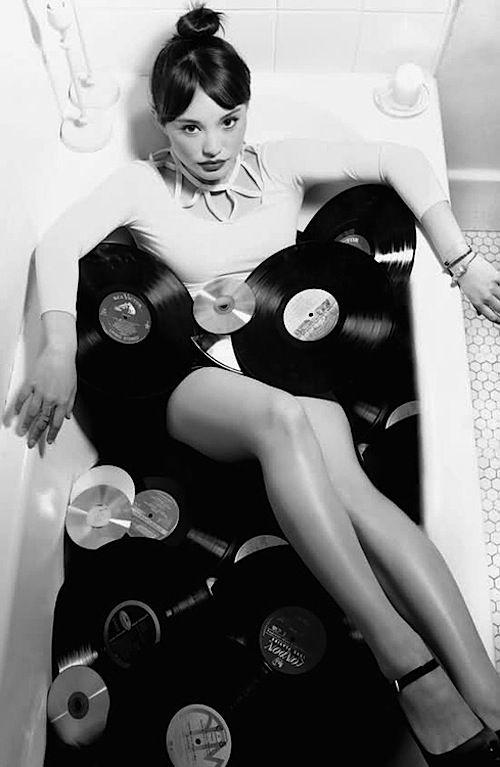 Having a bath of vinyl records:
