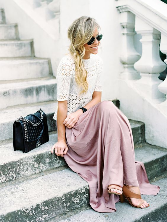 Mary Seng of Happily Grey in a lace top and rose colored skirt