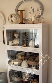 I like the layered look of the displays in this cabinet.