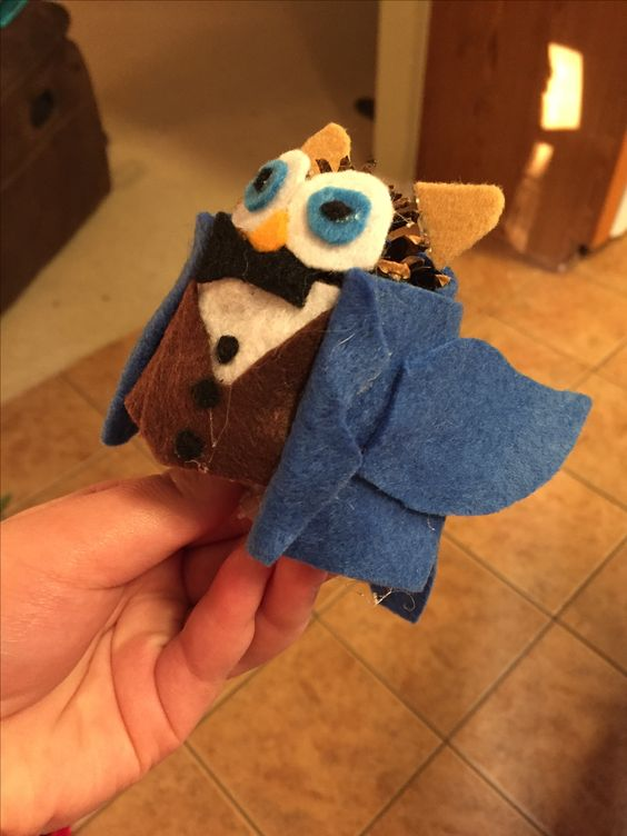So my mom and I like to make these little owls out of pine cones and felt and I made a little Newt Scamander owl!  by @HyruleanPikachu