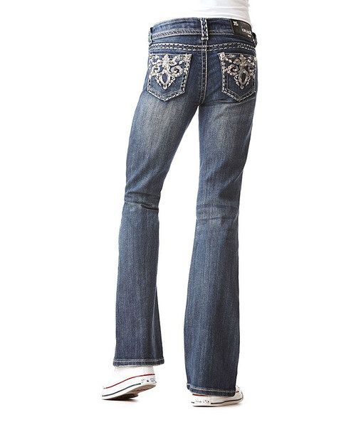 Flaunting five-pocket style and crystal-like rivets, this blinging pair goes beyond compare with rhinestone-studded embellishments on its handy back-button pockets.97% cotton / 3% spandexHand washImported