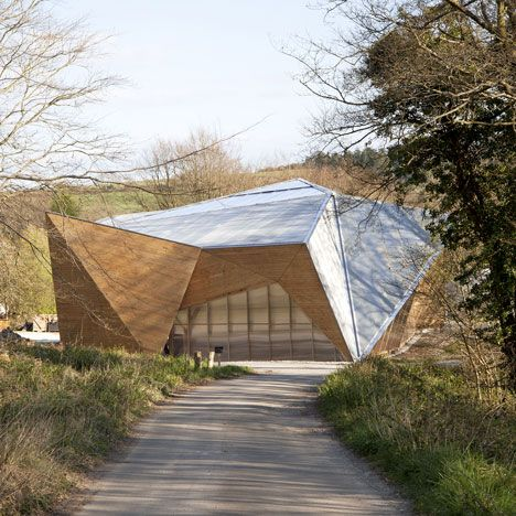 Students from London's Architectural Association have designed and built a faceted wooden workshop in the woods in Dorset, England.
