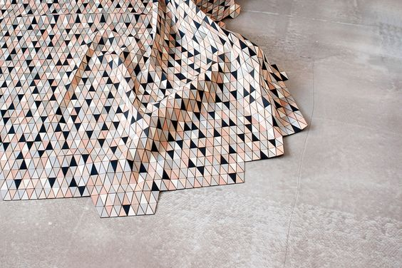 Young Berlin designer Elisa Strozyk creates textiles using faceted wood tiles.