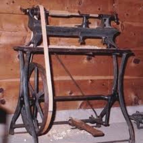 Way WAY old wood lathe with foot pedal. I want one of these on the garage.