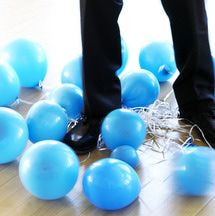 Battle of the Balloons is a party game for adults that only requires balloons and string. It's a great ice breaker for any size group.