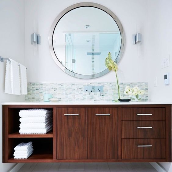 Image of Extraordinary Mid Century Bathroom Vanity from Wood Laminate Particle Board with Stainless Steel Cabinet Pulls Under Round Beveled Frameless Mirror also Polished Chrome Towel Bars also Bathroom Storage Cabinets Metal Wall Art for the Bathroom Bathroom Corner Vanity Cabinets Small Bathroom Decorating Ideas Modern Bathroom Decor Ideas