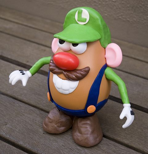 Mr. Potato Head + Luigi of Mario Bros. = Luigi Potato Head Bros.  Flickr user Ashley Ringrose (mrtruffle) creates Mr. Potato Head mash-ups; visit the source to see the whole collection.