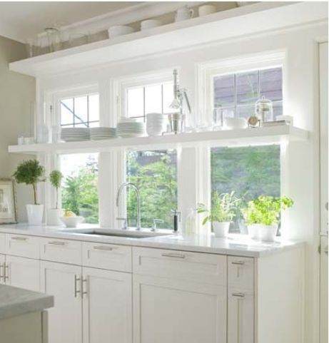 I love the bright white of this kitchen.: