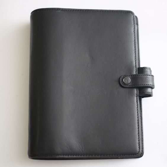 AVAILABLE Filofax Cavendish Calf Leather Black Personal Organizer Large Rings  Material: Calf leather Color: Black Features:  On the left: 8 credit card pockets full-height pocket On the right: full-height pocket secretarial pocket At the back: zipped full-height pocket With two leather pen loops and leather strap with visible popper Dimensions: 135cm x ca. 38cm x ca. 189cm Ring Size: 30mm (much larger than the usual 23mm of Filofax personal size planners)  In good preloved and used…
