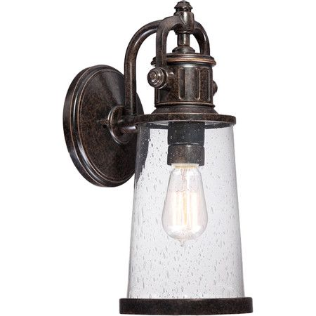 Showcasing an imperial bronze finish and glass shade, this classic wall sconce casts a warm glow in your home library or on the patio.