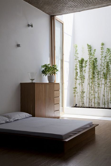 ANH House by Sanuki + Nishizawa / minimalist bedroom with masculine feel and bamboo out the window: