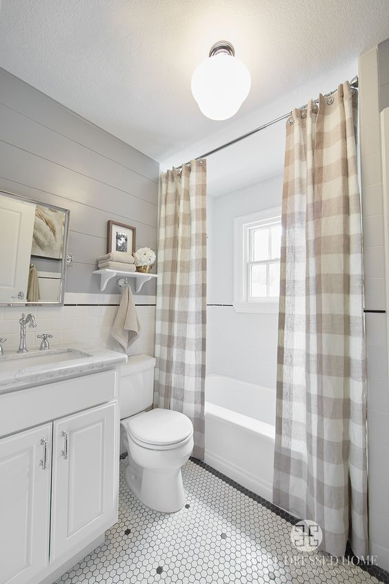 Kid's Bathroom by A Well Dressed Home, LLC. To read more about this project, please visit: http://awelldressedhome.com/3902-our-farmhouse-renovation-reveal-part-4-the-twins-rooms-and-bathroom/: