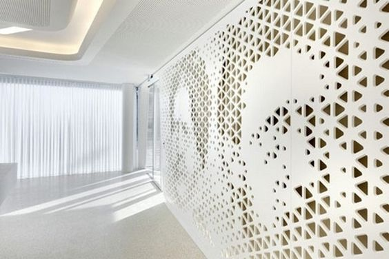Perforated walls with portraits modern bank interior for Interior decoration zurich