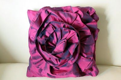style rose pillow from repurposed clothing. My previous ruffled pillow used the zipper of a skirt in order to make a removable cover. Also, the ruffles on the previous pillow rolled back. For this pillow, I made an envelope pillow cover and I attempted a flat ruffle. After two tries,