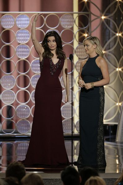 Tina Fey Photos - In this handout photo provided by NBCUniversal,  Hosts Tina Fey and Amy Poehler speak onstage during the 71st Annual Golden Globe Award at The Beverly Hilton Hotel on January 12, 2014 in Beverly Hills, California. - 71st Annual Golden Globe Awards Show