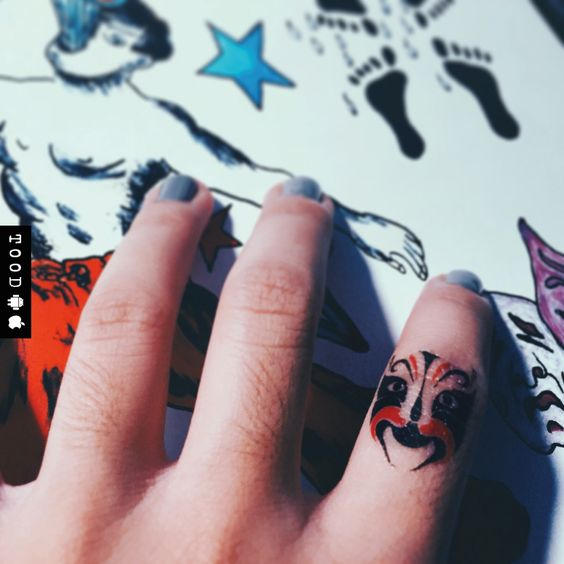 Chinese color mask temporary tattoo sticker on finger