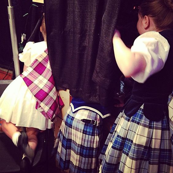 Girls trying to discretely watch the show from backstage.