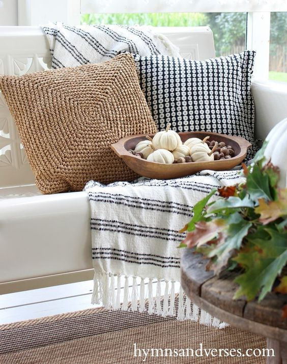 Fill a basket or bowl with small white baby boo pumpkins and some acorns for instant fall decor.