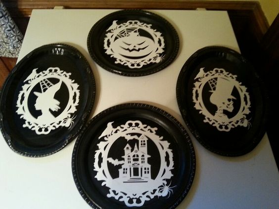 Dollar tree trays painted black with vinly cut outs